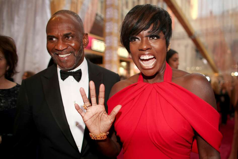 Actors Julius Tennon (L) and Viola Davis attend the 89th Annual Academy Awards at Hollywood & Highland Center on February 26, 2017 in Hollywood, California.