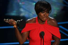 """Actress Viola Davis delivers a speech on stage after she won the award for Best Supporting Actress in """"Fences"""" at the 89th Oscars on February 26, 2017 in Hollywood, California."""