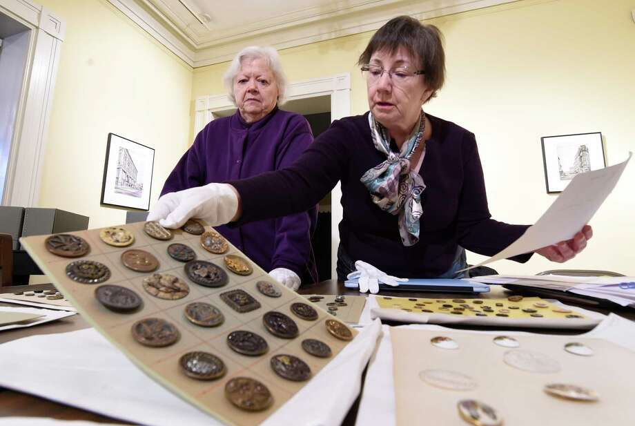 Antique buttons are check for their quality of preservation and their intrinsic value at the Rensselaer County Historical Society  Wednesday  Feb. 22, 2017 in Troy, N.Y.  (Skip Dickstein/Times Union) Photo: SKIP DICKSTEIN / 40039748A