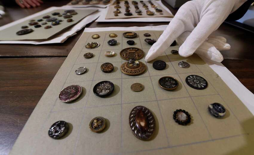 Antique buttons are check for their quality of preservation and their intrinsic value at the Rensselaer County Historical Society Wednesday Feb. 22, 2017 in Troy, N.Y. (Skip Dickstein/Times Union)
