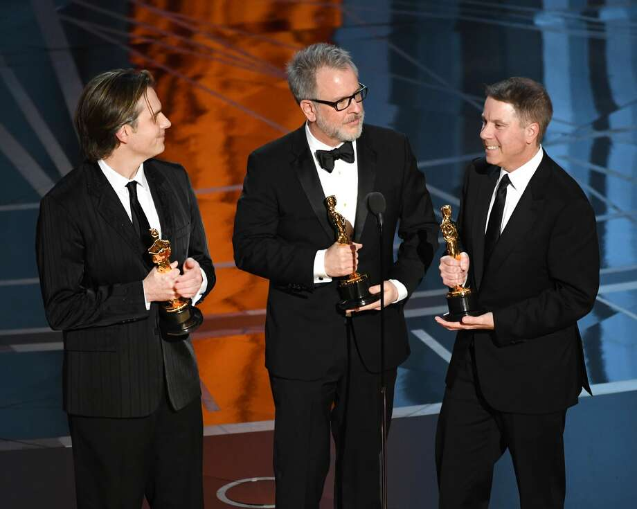 (L-R) Co-directors Byron Howard and Rich Moore and producer Clark Spencer accept Best Animated Feature Film for 'Zootopia' onstage during the 89th Annual Academy Awards at Hollywood & Highland Center on February 26, 2017 in Hollywood, California. Photo: Kevin Winter/Getty Images