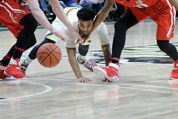 Marquis Wright of Siena scrambles for a loose ball during their game against Marist on Sunday, Feb. 26, 2017, in Albany, N.Y.   (Paul Buckowski / Times Union)