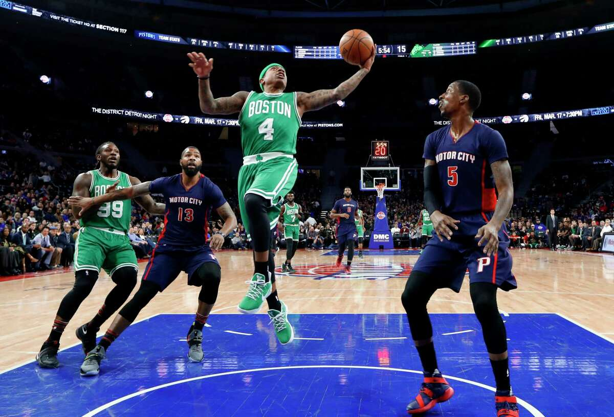 Boston Celtics guard Isaiah Thomas (4) drives against the Detroit Pistons in the first half of an NBA basketball game in Auburn Hills, Mich., Sunday, Feb. 26, 2017. (AP Photo/Paul Sancya) ORG XMIT: MIPS107
