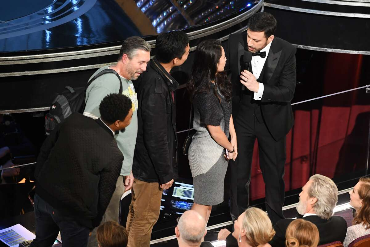 Host Jimmy Kimmel (R) surprises tourists with an entrance to the 89th Annual Academy Awards at Hollywood & Highland Center on February 26, 2017 in Hollywood.