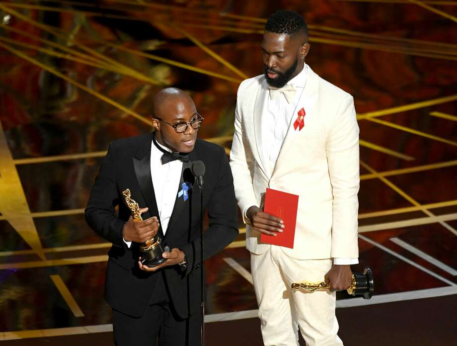 HOLLYWOOD, CA - FEBRUARY 26:  Writer/director Barry Jenkins (L) and writer Tarell Alvin McCraney accept Best Adapted Screenplay for 'Moonlight' onstage during the 89th Annual Academy Awards at Hollywood & Highland Center on February 26, 2017 in Hollywood, California.  (Photo by Kevin Winter/Getty Images) Photo: Kevin Winter/Getty Images