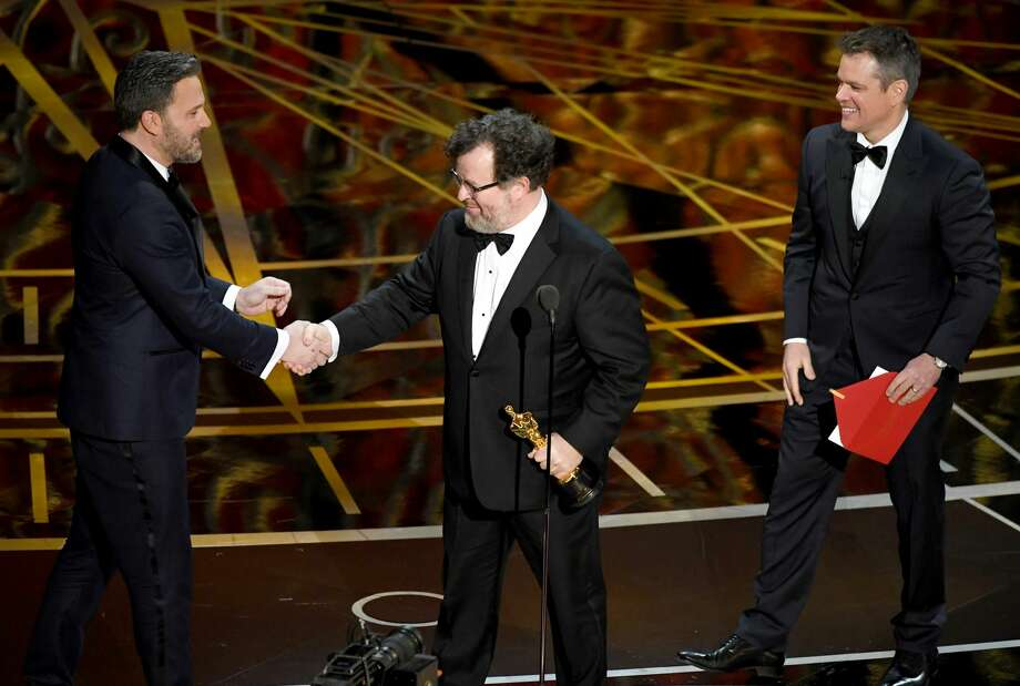 Writer/director Kenneth Lonergan (center) accepts Best Original Screenplay for 'Manchester by the Sea' from actor/director Ben Affleck (left) and actor/producer Matt Damon (right) onstage during the 89th Annual Academy Awards at Hollywood & Highland Center on February 26, 2017 in Hollywood, California.  Photo: Kevin Winter/Getty Images
