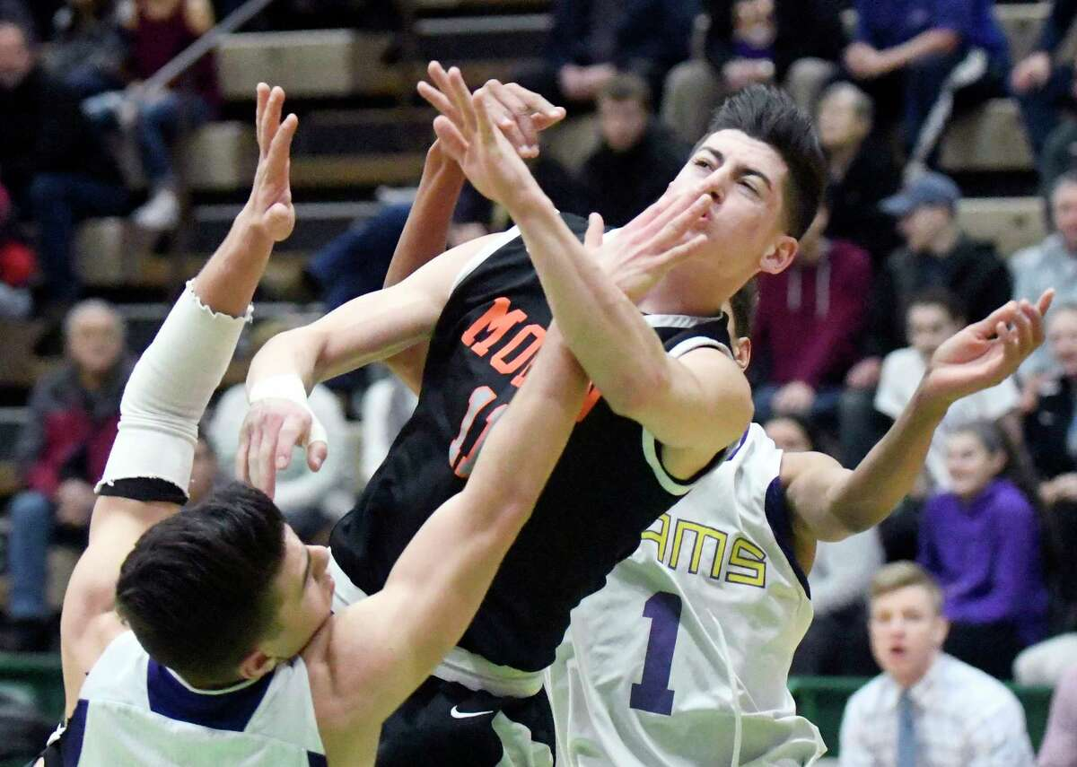 Mohonasen's Brandon Kruzinski (11) watches his shot as he is fouled by Amsterdam players during the first half of a Section II Class A boys' basketball quarterfinal game on Sunday, Feb. 26, 2017, in Troy, N.Y. (Hans Pennink / Special to the Times Union) ORG XMIT: HP