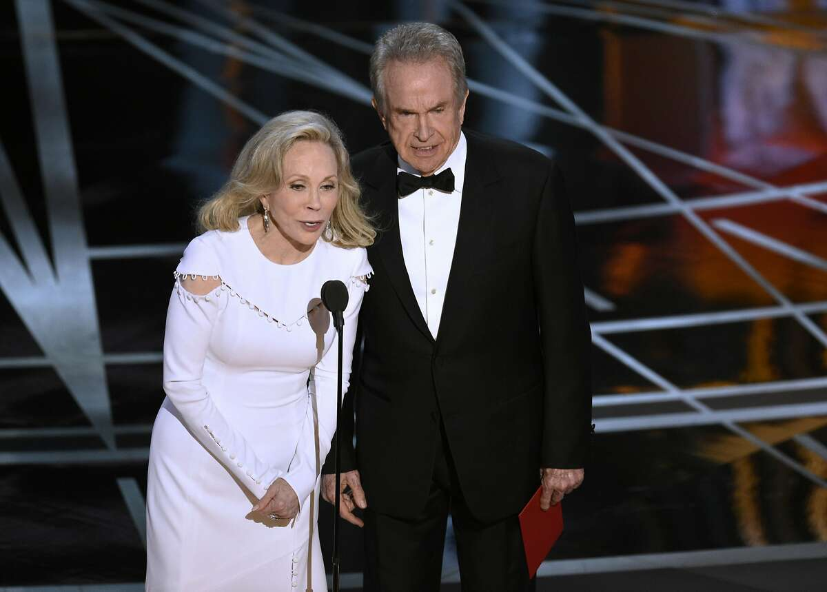 Faye Dunaway, left, and Warren Beatty present the award for best picture at the Oscars.
