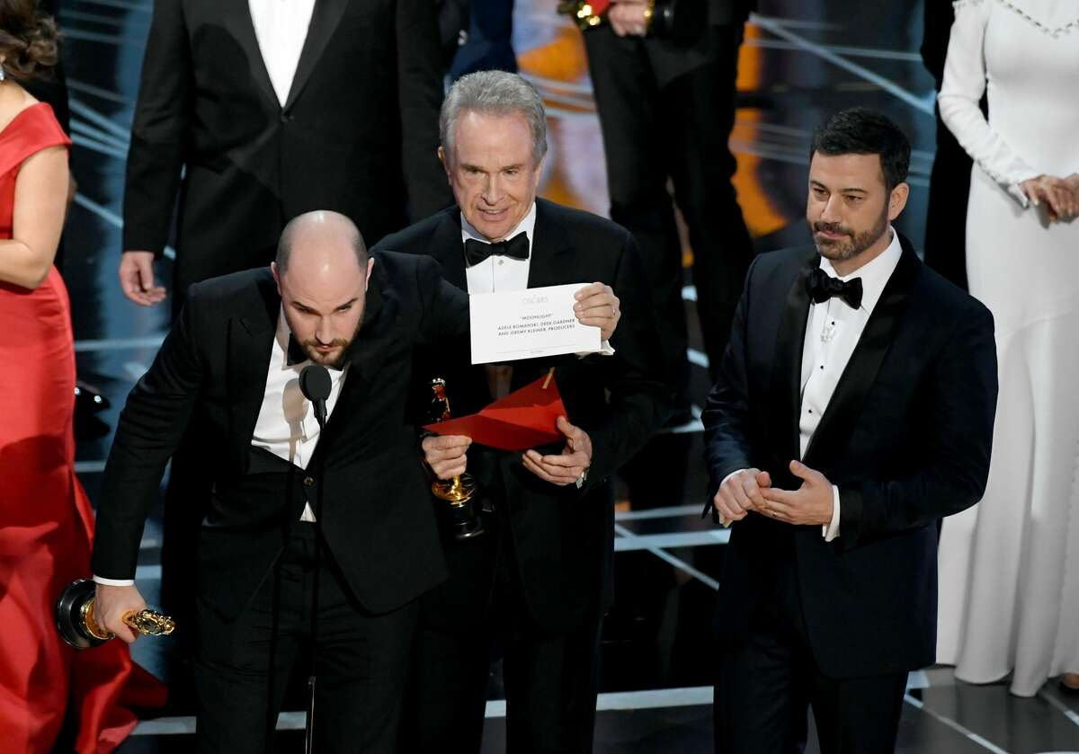 'La La Land' producer Jordan Horowitz holds up the winner card reading actual Best Picture winner 'Moonlight' with actor Warren Beatty and host Jimmy Kimmel onstage during the 89th Annual Academy Awards at Hollywood & Highland Center on February 26, 2017 in Hollywood, California. (Photo by Kevin Winter/Getty Images)