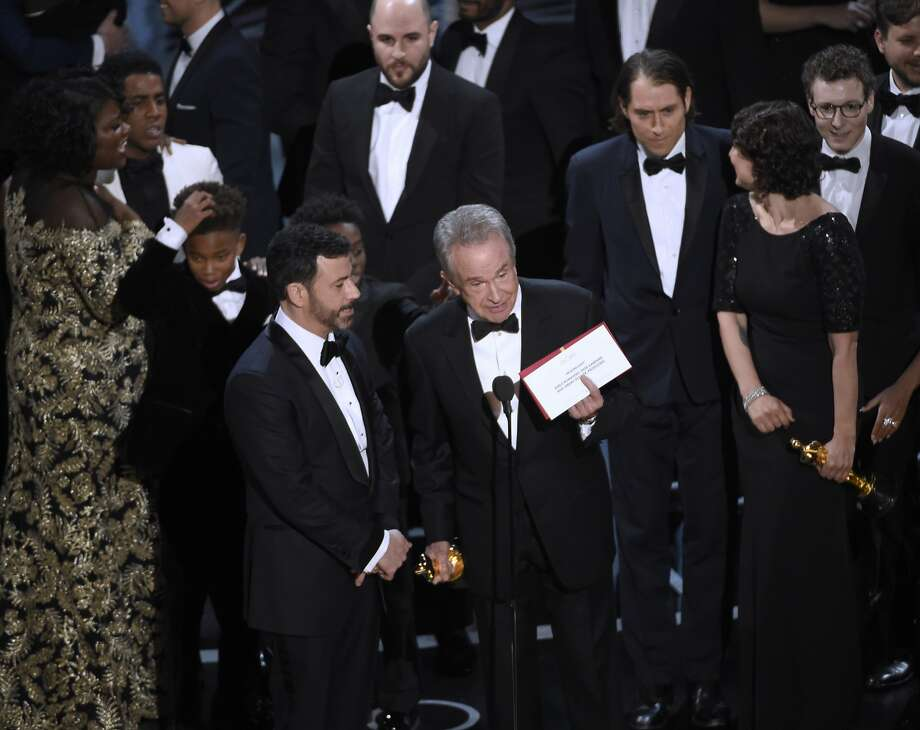 "Presenter Warren Beatty shows the envelope with the actual winner for best picture as host Jimmy Kimmel, left, looks on at the Oscars on Sunday, Feb. 26, 2017, at the Dolby Theatre in Los Angeles. The winner was originally announced as ""La La Land,"" but was later corrected to ""Moonlight."" (Photo by Chris Pizzello/Invision/AP) Photo: Chris Pizzello, Associated Press"