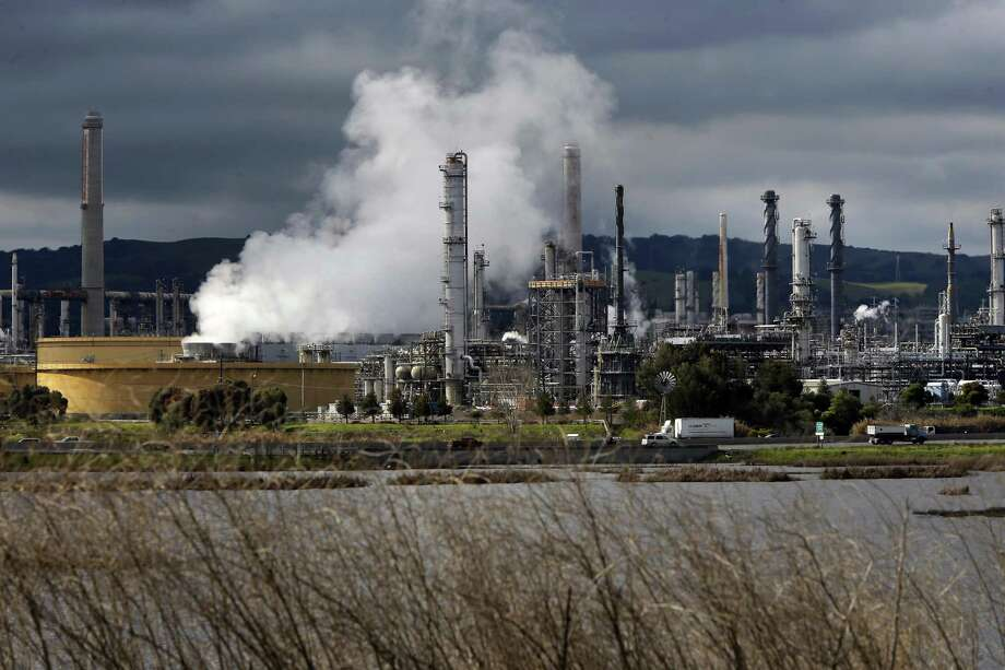 The proposal would tax carbon-emitting industries at a starting rate of $40 per ton at the point of production — such as a refinery. In addition, taxes on carbon would ratchet upward over time. Photo: Michael Macor /San Francisco Chronicle / ONLINE_YES
