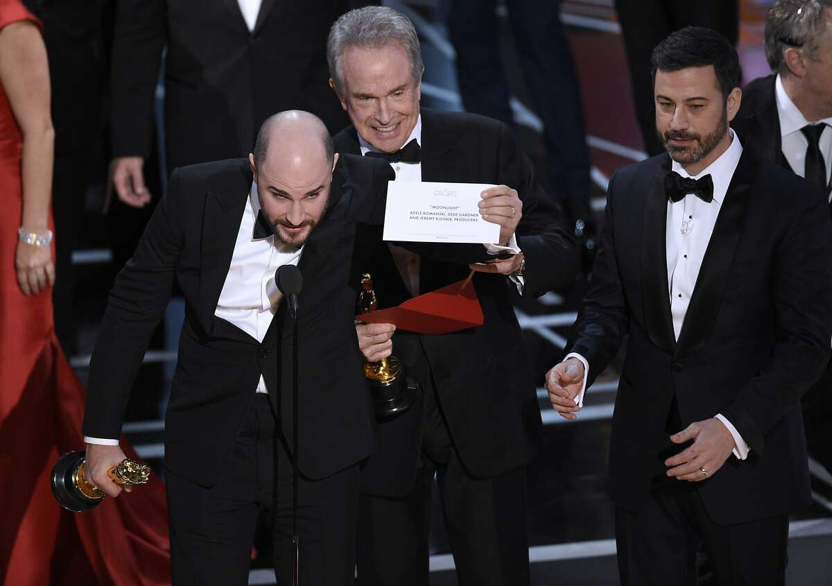 """Jordan Horowitz, producer of """"La La Land,"""" shows the envelope revealing """"Moonlight"""" as the true winner of best picture at the Oscars on Sunday, Feb. 26, 2017."""