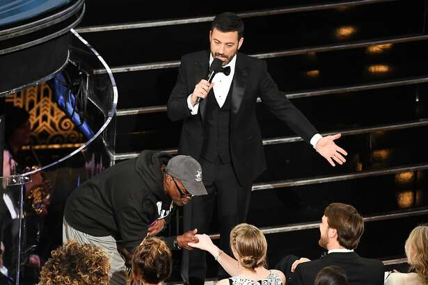 HOLLYWOOD, CA - FEBRUARY 26:  Host Jimmy Kimmel (R) surprises tourists with an entrance to the 89th Annual Academy Awards at Hollywood & Highland Center on February 26, 2017 in Hollywood, California.  (Photo by Kevin Winter/Getty Images)