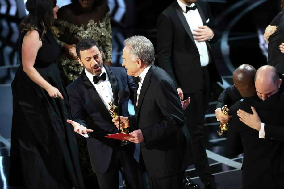 """Jimmy Kimmel with Warren Beatty after he showed the card for Best Picture winner """"Moonlight"""" after """"La La Land"""" was incorrectly presented the Oscar during the 89th Academy Awards at the Dolby Theatre in Los Angeles, Feb. 26, 2017. (Patrick T. Fallon/The New York Times) Photo: PATRICK T. FALLON, NYT / NYTNS"""