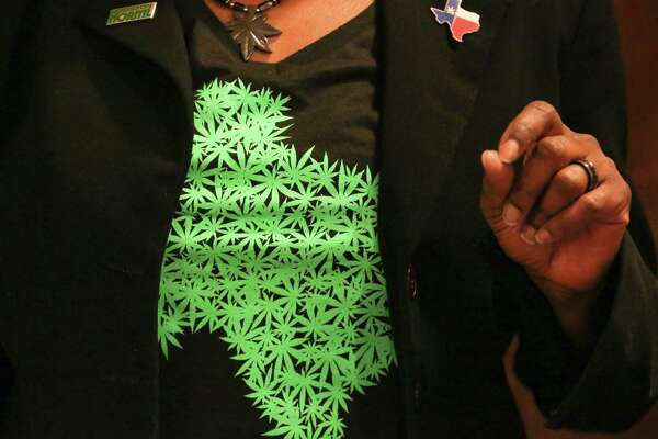 T. Watson, Secretary of Houston Chapter of the National Organization for the Reform of Marijuana Laws, wears a marijuana leaf necklace and a marijuana Texas shape T-shirt to the group's meeting at Midtown Bat & Grill on Thursday, February 16, in Houston.