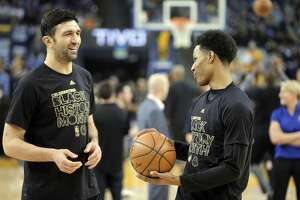 Zaza Pachulia (27) during warmups with Patrick McCaw (0) before the Golden State Warriors played the Los Angeles Clippers at Oracle Arena in Oakland, Calif., on Thursday, February 23, 2017.