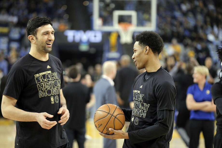 Zaza Pachulia (27) during warmups with Patrick McCaw (0) before the Golden State Warriors played the Los Angeles Clippers at Oracle Arena in Oakland, on Thursday, February 23, 2017. Photo: Carlos Avila Gonzalez, The Chronicle