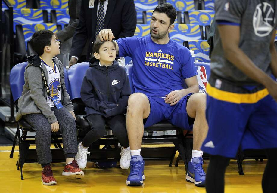 Zaza Pachulia plays with his son Saba's, 7, hair as Davit, 8, watches before the Golden State Warriors played the Los Angeles Clippers at Oracle Arena in Oakland, Calif., on Thursday, February 23, 2017. Photo: Carlos Avila Gonzalez, The Chronicle