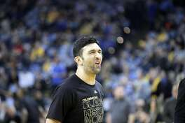Zaza Pachulia (27) reacts to missing a shot during warmups before the Golden State Warriors played the Los Angeles Clippers at Oracle Arena in Oakland, Calif., on Thursday, February 23, 2017.