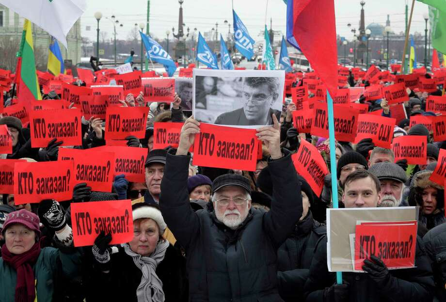 People hold posters reading 'Who ordered the murder?' during a rally in memory of opposition leader Boris Nemtsov in St. Petersburg, Russia, Sunday, Feb. 26, 2017. Thousands of Russians have taken to the streets of Moscow and St. Petersburg to mark two years since Nemtsov was gunned down outside the Kremlin. (AP Photo/Dmitri Lovetsky) Photo: Dmitri Lovetsky, STF / Copyright 2017 The Associated Press. All rights reserved.