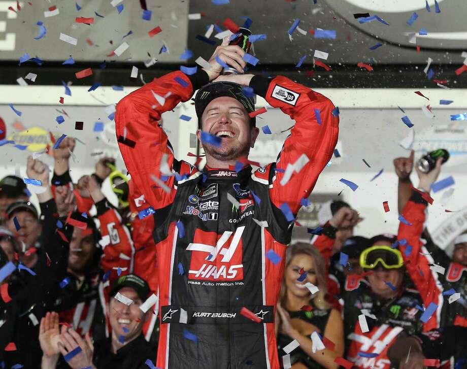 Kurt Busch celebrates in Victory Lane after winning the Daytona 500. It was his first Daytona 500 win in 16 tries. Photo: Stephen M. Dowell, MBR / Orlando Sentinel