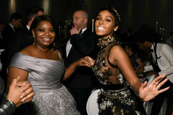 "Nominee for Best Supporting Actress ""Hidden Figures"" Octavia Spencer and musician Janelle Monae (R) pose with guests at the 89h Annual Academy Awards Governors Ball in Hollywood, California, on February 26, 2017."