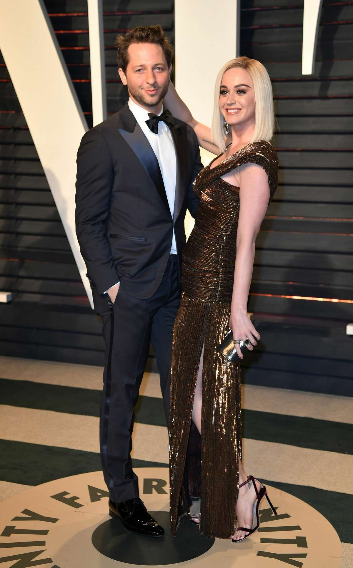 Katy Perry (R) and Derek Blasberg (L) pose as they arrive at the Vanity Fair Oscar Party in Beverly Hills, California, Los Angeles on February 26, 2017.