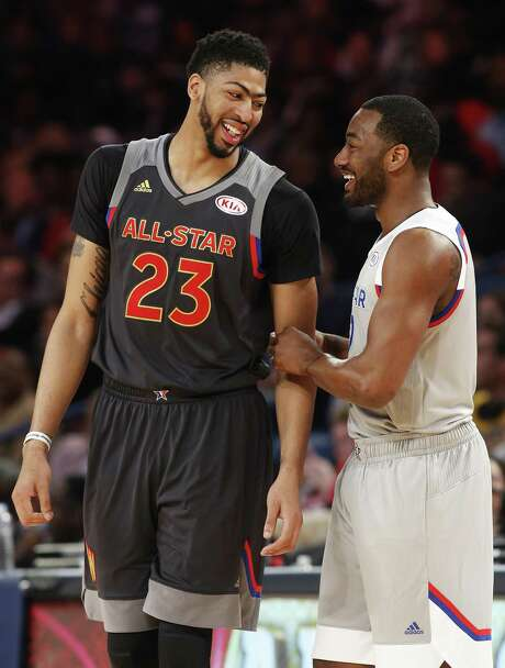 Western Conference forward Anthony Davis of the New Orleans Pelicans (23) laughs with Eastern Conference guard John Wall of the Washington Wizards (2) in the second half of the NBA All-Star basketball game in New Orleans, Sunday, Feb. 19, 2017. (AP Photo/Max Becherer) Photo: Max Becherer, FRE / Associated Press / Max Becherer