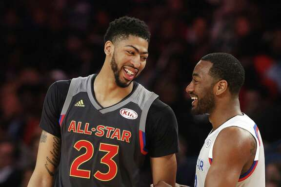 Western Conference forward Anthony Davis of the New Orleans Pelicans (23) laughs with Eastern Conference guard John Wall of the Washington Wizards (2) in the second half of the NBA All-Star basketball game in New Orleans, Sunday, Feb. 19, 2017. (AP Photo/Max Becherer)