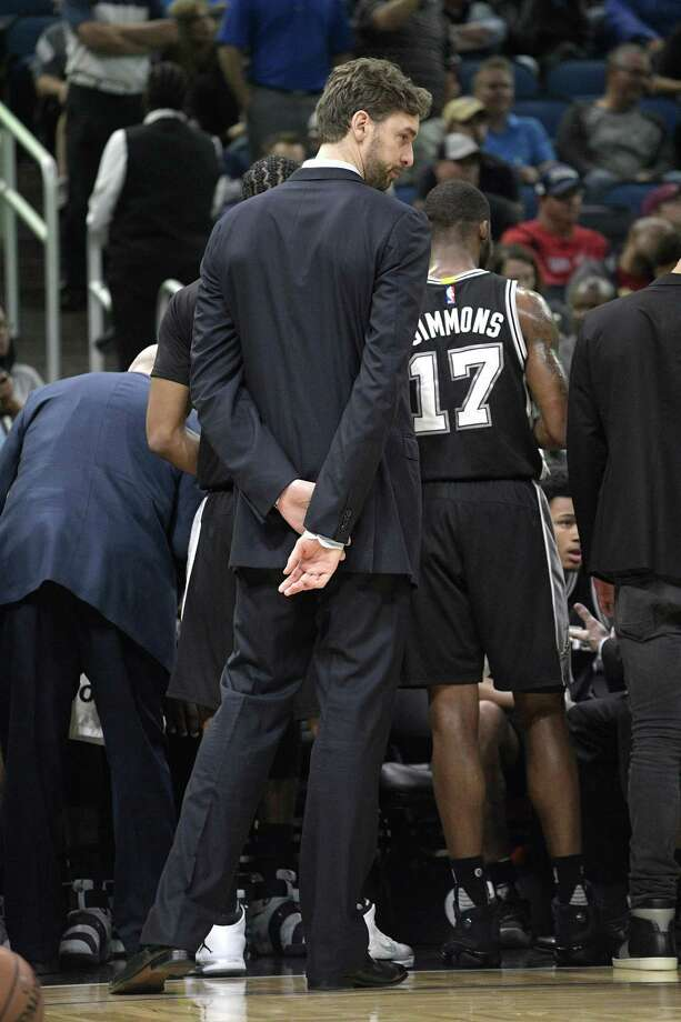San Antonio Spurs center Pau Gasol stands outside a huddle during a timeout in the second half of an NBA basketball game against the Orlando Magic in Orlando, Fla., Wednesday, Feb. 15, 2017. The Spurs won 107-79. (AP Photo/Phelan M. Ebenhack) Photo: Phelan M. Ebenhack, FRE / Associated Press / FR121174 AP