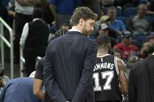 San Antonio Spurs center Pau Gasol stands outside a huddle during a timeout in the second half of an NBA basketball game against the Orlando Magic in Orlando, Fla., Wednesday, Feb. 15, 2017. The Spurs won 107-79. (AP Photo/Phelan M. Ebenhack)