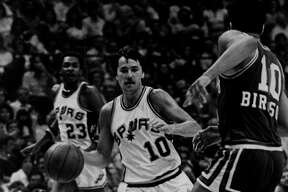 Louie Dampier of the Spurs brings the ball up the court against Kansas City's Otis Birdsong in 1978 at HemisFair Arena in San Antonio.