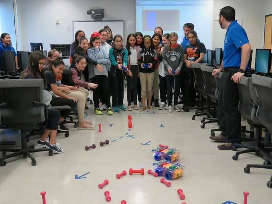 Sixth-grade students build Mars rover replica robots with engineers from Lackland Air Force Base during the 2017 STEM Alliance at TAMIU on Friday. Photo: Courtesy /U.S. Congressman Henry Cuellar's Office.