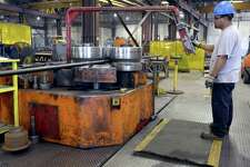 Javier Perez of Alamo Iron Works operates a pipe bending machine in the company's San Antonio manufacturing facility. The February Manufacturing Outlook Survey conducted by the Dallas Fed indicated continued positive conditions for Texas-based manufacturers.
