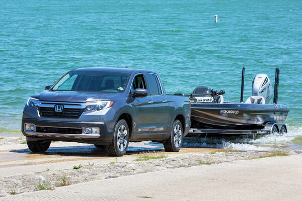 Rated to tow up to 5,000 pounds, the all-wheel-drive Ridgeline's traction management system offers normal, snow, mud and sand modes..