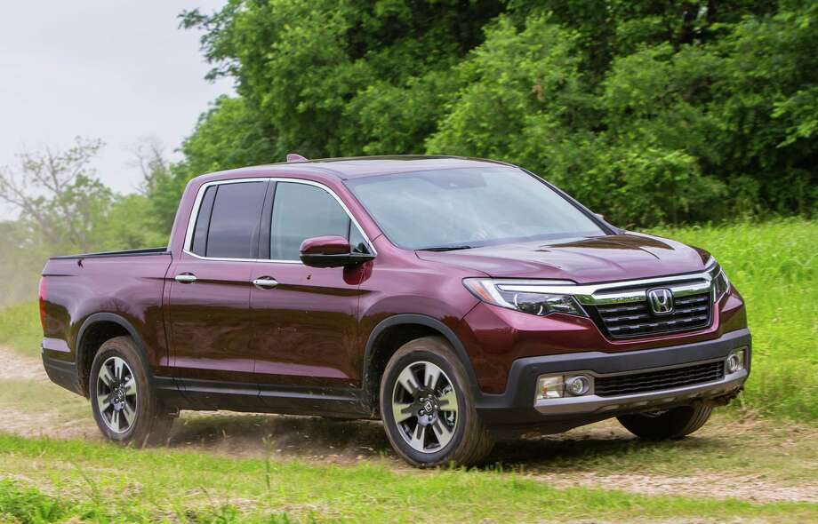 Available in FWD or AWD, Honda offers seven trim levels of the Ridgeline midsize pickup, starting at $29,475. Photo: Honda / Copyright 2016