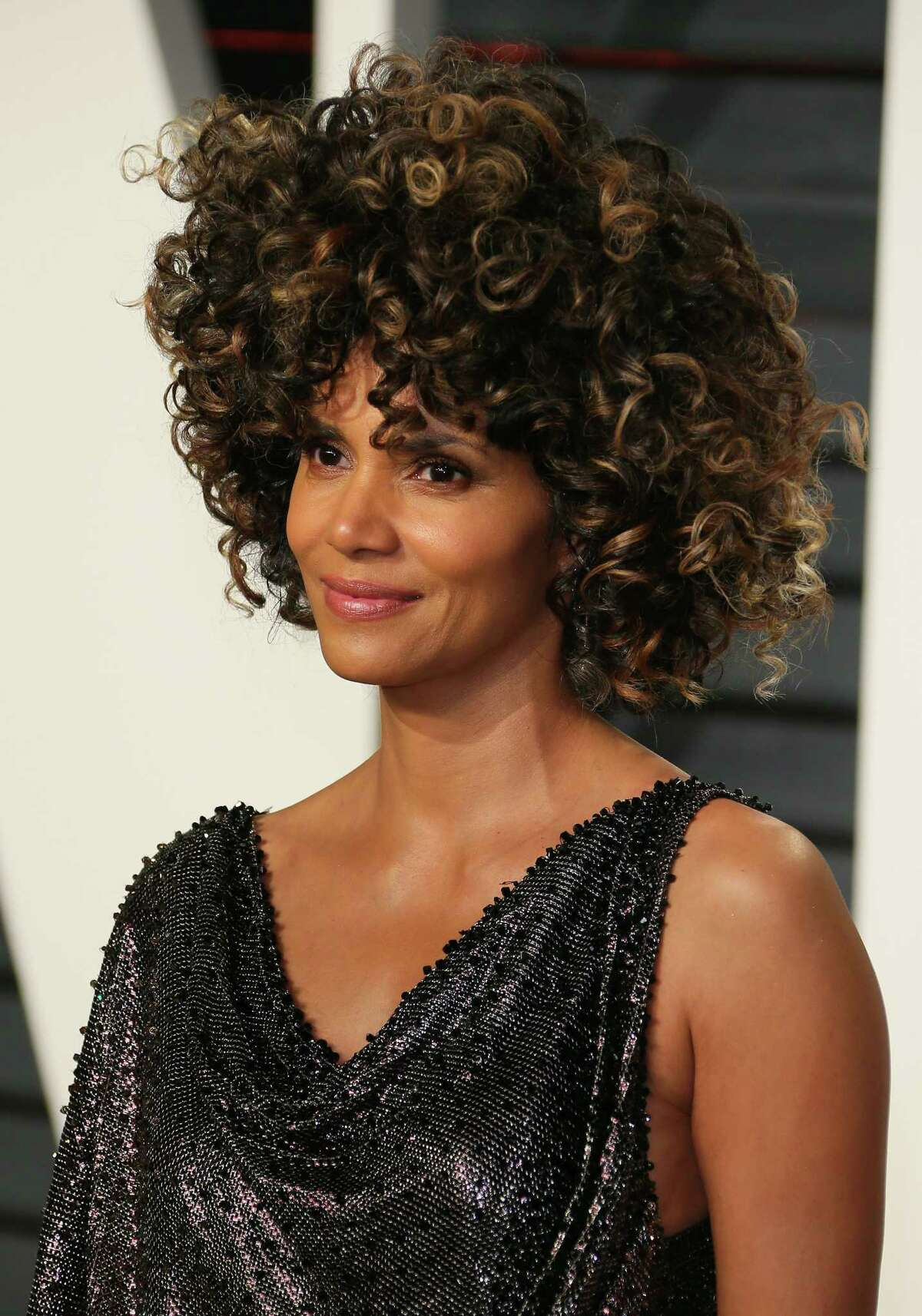 Halle Berry wearing an asymmetrical Afro, according to her hairstylist.
