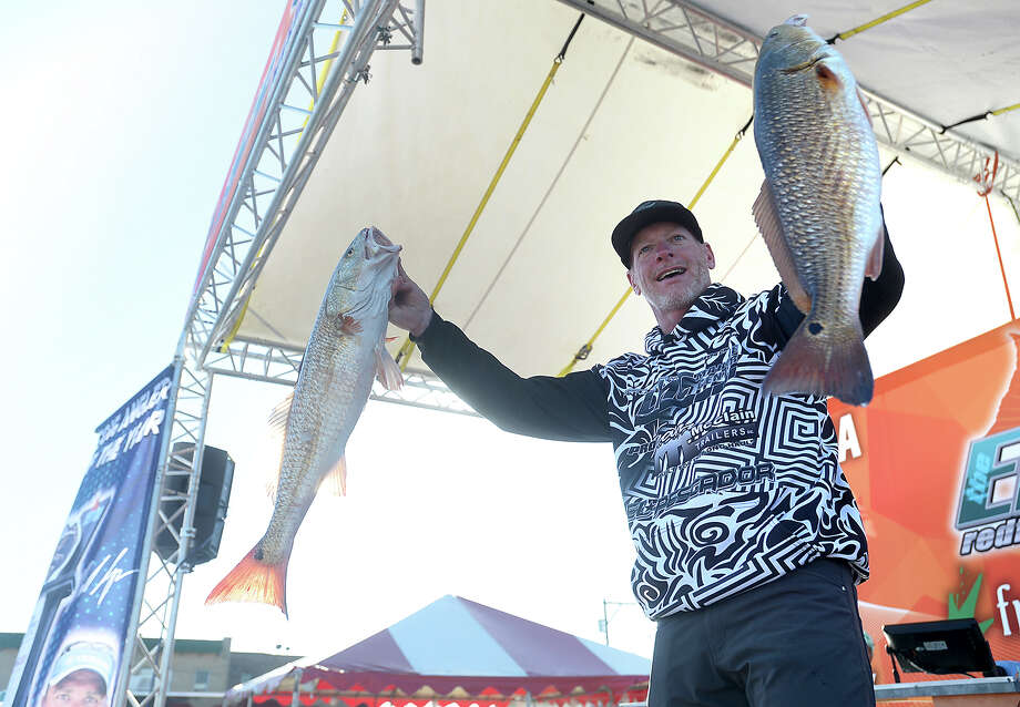 Angler David Christian displays his catch during weigh-in on the second day of the Elite Redfish Series Kick Off Classic fishing tournament Friday in Port Arthur. Weigh-ins throughout the weekend-long competition are taking place on the main stage of the Mardi Gras of Southeast Texas event. Photo taken Saturday, February 25, 2017 Kim Brent/The Enterprise Photo: Kim Brent