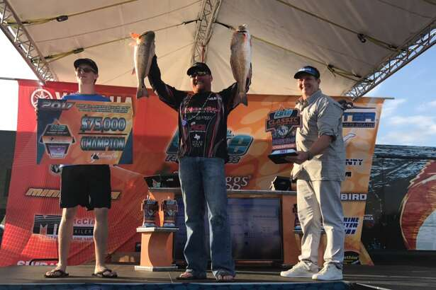 Victoria professional angler Mark Robinson won the Elite Redfish Series Classic Kickoff with a total weekend catch of nine redfish, 64.95 pounds on Sunday, Feb. 27, 2017, in Port Arthur. Robinson won the grand prize of a $75,000 Skeeter boat. Brooks Kubena/The Enterprise