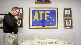 ATF Special Agent Eric Evers looks at a model of the Branch Davidian compound where the ATF attempted to serve a warrant in 1993, Monday, Jan. 9, 2017, in Houston.