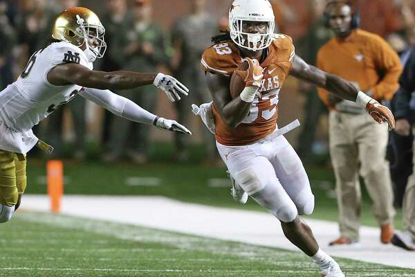 D'onto Foreman cruises down the sideline in the second half as Texas hosts Notre Dame at DKR Stadium on September 4, 2016.