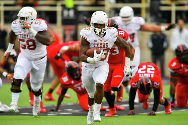 LUBBOCK, TX - NOVEMBER 05: D'Onta Foreman #33 of the Texas Longhorns break free for yardage during the first half of the game between the Texas Tech Red Raiders and the Texas Longhorns on November 5, 2016 at AT&T Jones Stadium in Lubbock, Texas. (Photo by John Weast/Getty Images)