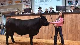 Aven Horn of Abilene, Tx., smiles after her Grand Champion steer, Prince, brought in $106,000 during the annual San Antonio Stock Show and Rodeo auction Saturday.