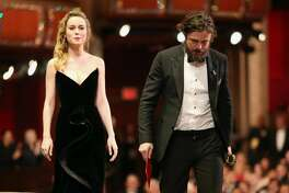 Actor Casey Affleck (R) accepts the Best Actor award for 'Manchester by the Sea'  from presenter Brie Larson onstage onstagee during the 89th Annual Academy Awards at Hollywood & Highland Center on February 26, 2017 in Hollywood, California.