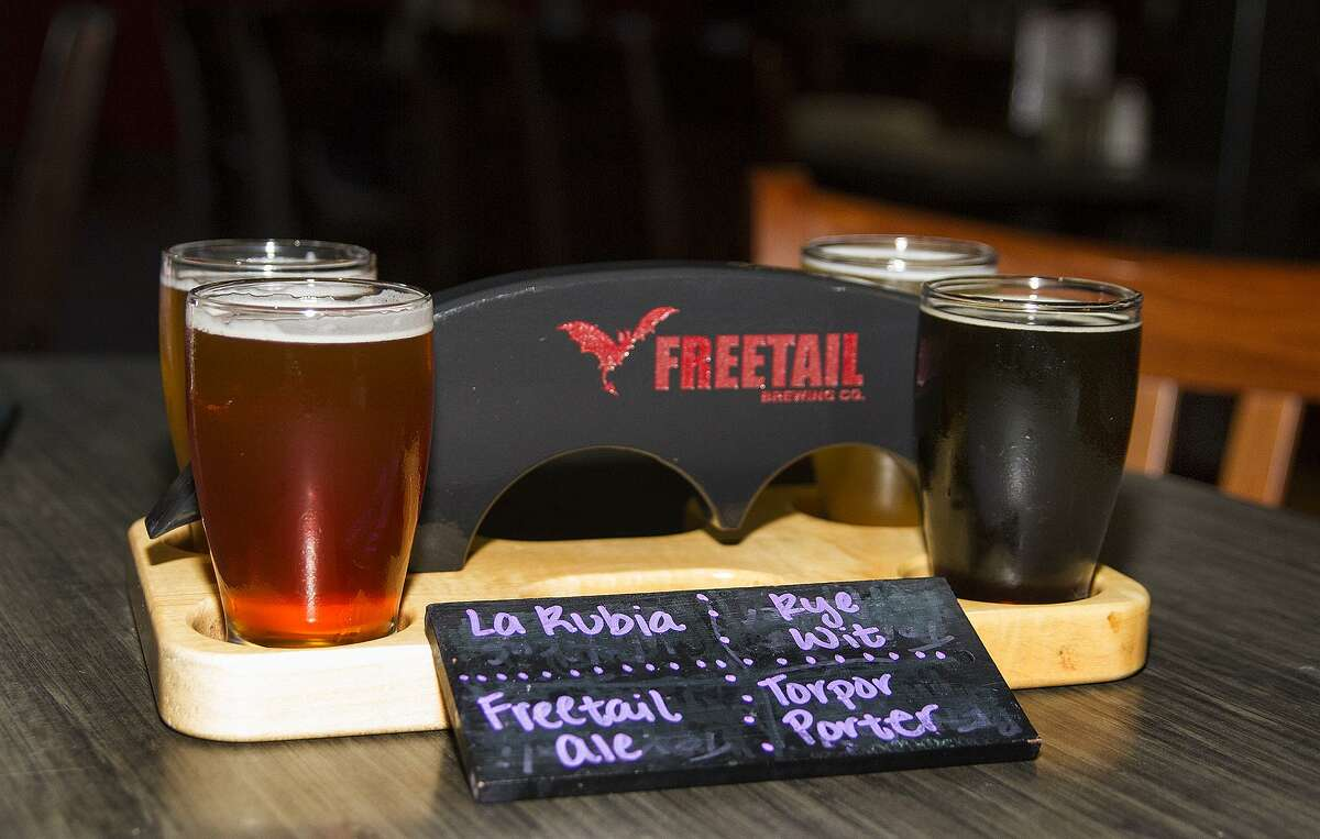 A flight of beers from Freetail Brewing Co. includes four five oz. beers.