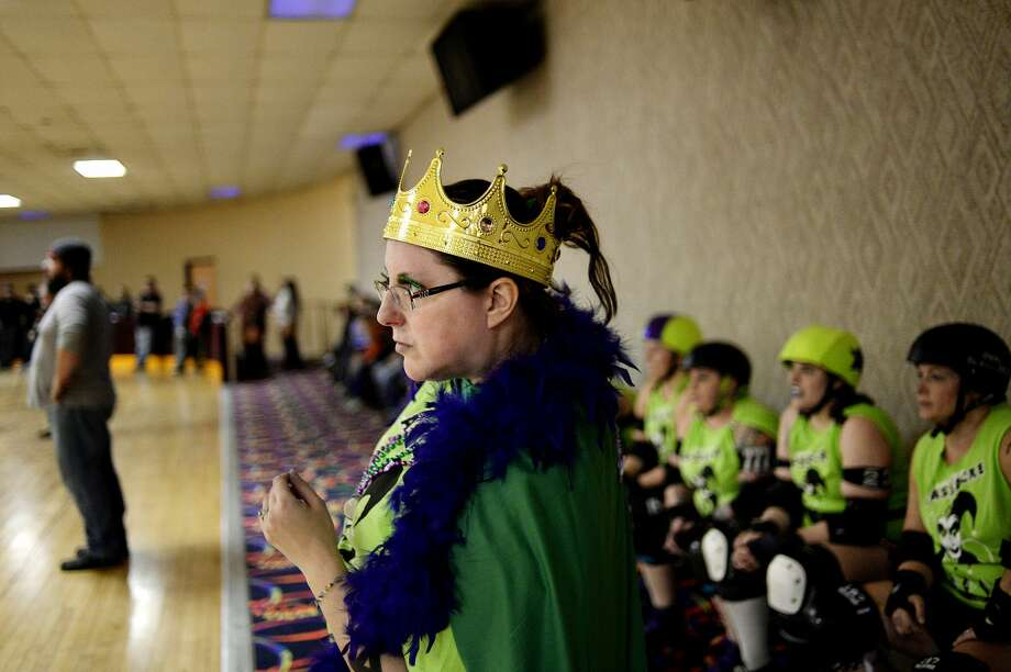Ruby Aker, also known as Miss Ru-D, looks on as coach of the Queen Cakes during the Mardi Gras Massacre roller derby event on Saturday at the Roll Arena in Midland. Aker is the head coach of the Chemical City Derby Girls team. The event was hosted by the Chemical City Derby Girls team, which is back after a two-year team-rebuilding hiatus. The derby was a mixed-team scrimmage, which featured athletes from the Chemical City Derby Girls and from teams around the state. Photo: NICK KING | Nking@mdn.net