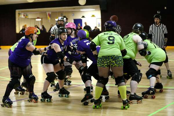 Members of the Queen Cakes and Punchkies make up the pack during the Mardi Gras Massacre roller derby event on Saturday at the Roll Arena in Midland. The event was hosted by the Chemical City Derby Girls team, which is back after a two-year team-rebuilding hiatus. The derby was a mixed-team scrimmage, which featured athletes from the Chemical City Derby Girls and from teams around the state.