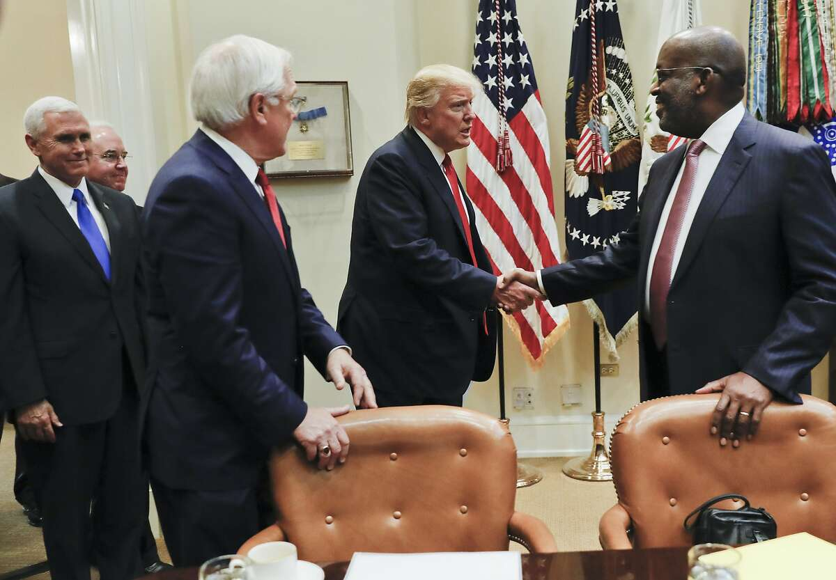 President Donald Trump, center, greets Bernard J. Tyson, right, CEO of Kaiser Permanente, and Joseph R. Swedish, left, CEO of Anthem and during a meeting with health insurance company executives in the Roosevelt Room of the White House in Washington, Monday, Feb. 27, 2017. Also attending the meeting Vice President Mike Pence, far left, and Health and Human Services Secretary Tom Price. (AP Photo/Pablo Martinez Monsivais)