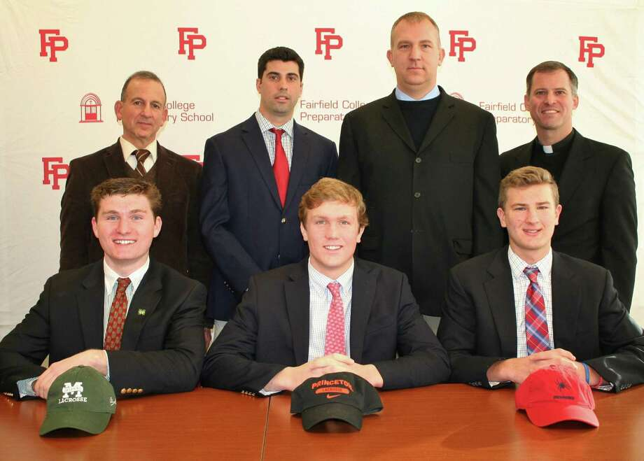 Fairfield Prep announced that three student-athletes have signed to play college lacrosse. First row: Jack Kornutik (Manhattan); Chris Brown (Princeton) and Mitch Savoca (Richmond). Second row, L to R: Prep principal Dr. Robert Perrotta, athletic director Tom Curran, lacrosse coach Graham Niemi and Pres. Rev. Tom Simisky, S.J. Photo: Contributed / Contributed