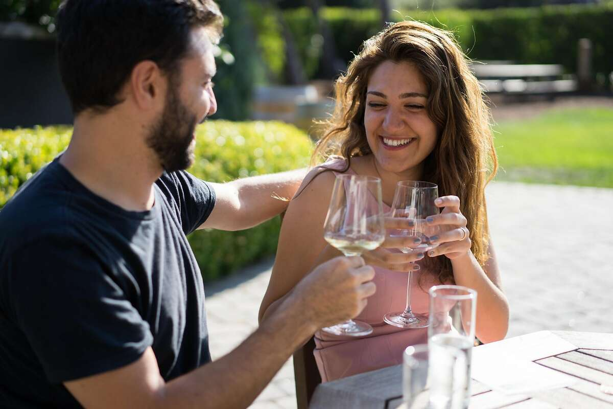 Hisham, left, and Hind Zawil sample wine at Folktale Winery in Carmel, Calif. on Sunday, Aug. 30, 2015. The winery features a new outdoor pavilion for guests to enjoy.